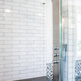 Inspiration for a large transitional master white tile and ceramic tile ceramic tile and multicolored floor bathroom remodel in Denver with shaker cabinets, blue cabinets, a one-piece toilet, gray walls, a vessel sink, quartz countertops, a hinged shower door and gray countertops