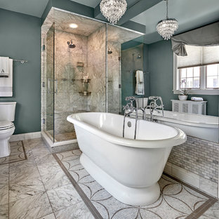 Inspiration for a mid-sized transitional master gray tile and stone tile mosaic tile floor and gray floor bathroom remodel in Chicago with a two-piece toilet, blue walls and a hinged shower door