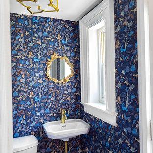 Ejemplo de cuarto de baño con ducha, tradicional renovado, pequeño, con sanitario de una pieza, paredes azules, suelo de mármol, lavabo suspendido, suelo amarillo y encimeras blancas
