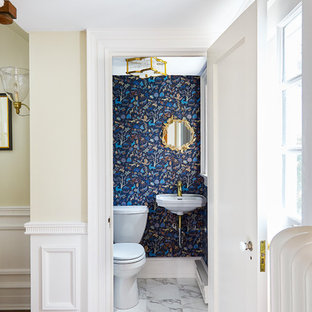Inspiration for a small transitional 3/4 marble floor and yellow floor bathroom remodel in Wilmington with a one-piece toilet, blue walls, a wall-mount sink and white countertops