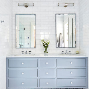 Mid-sized transitional master white tile and ceramic tile marble floor and multicolored floor alcove shower photo in Wilmington with flat-panel cabinets, gray cabinets, an undermount sink, marble countertops, a hinged shower door and white countertops