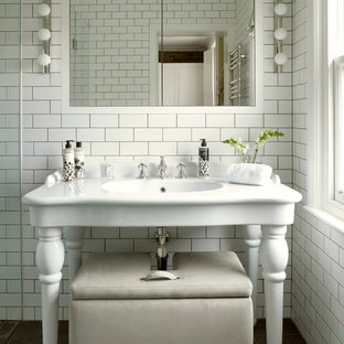 Doorless shower - mid-sized victorian master white tile and subway tile slate floor and gray floor doorless shower idea in London with a console sink, flat-panel cabinets, white cabinets, a wall-mount toilet, white walls and a hinged shower door