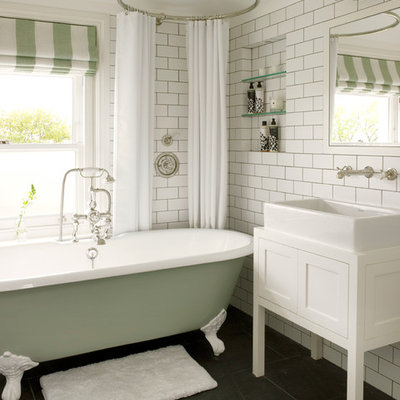 Inspiration for a small transitional kids' white tile and subway tile slate floor and gray floor bathroom remodel in London with a vessel sink, furniture-like cabinets, white cabinets, a wall-mount toilet, white walls, wood countertops and white countertops