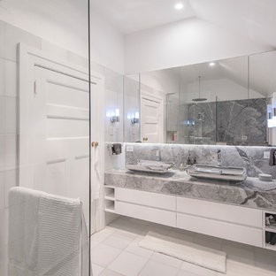 Design ideas for a mid-sized contemporary master bathroom in Brisbane with flat-panel cabinets, an alcove shower, ceramic tile, white walls, a vessel sink, marble benchtops, white floor, an open shower, grey benchtops, white cabinets and gray tile.