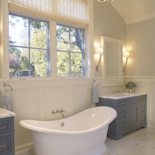 Traditional bathroom in San Francisco with a freestanding tub and blue cabinets.