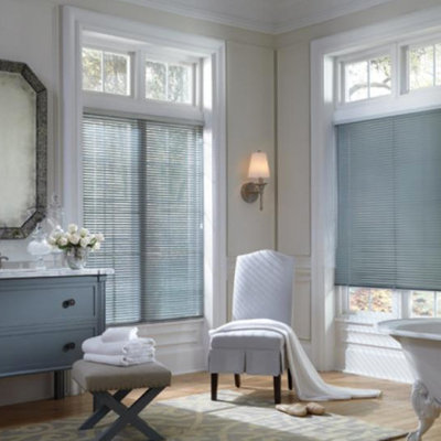 Example of a large cottage chic master gray tile and white tile light wood floor freestanding bathtub design in Baltimore with flat-panel cabinets, blue cabinets, a two-piece toilet, beige walls, a drop-in sink and marble countertops