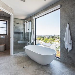 Expansive contemporary bathroom in Brisbane with marble benchtops.