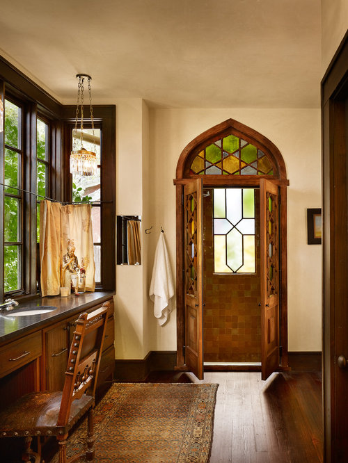 example of an ornate bathroom design in austin with an undermount sink flatpanel