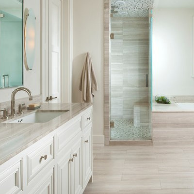 Inspiration for a timeless beige tile and limestone tile bathroom remodel in Dallas with an undermount sink, an undermount tub, white cabinets and gray countertops