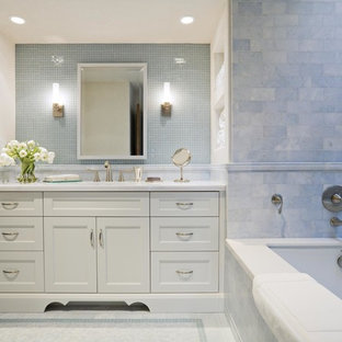 Alcove bathtub - traditional blue tile and mosaic tile alcove bathtub idea in San Francisco with an undermount sink, recessed-panel cabinets and white cabinets