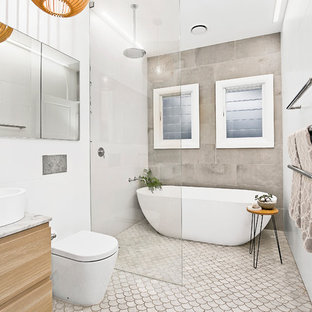 Inspiration for a contemporary master bathroom in Sydney with flat-panel cabinets, medium wood cabinets, a freestanding tub, an open shower, a one-piece toilet, beige tile, white walls, a console sink and an open shower.
