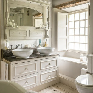 Inspiration for a medium sized farmhouse family bathroom in Other with shaker cabinets, white cabinets, a claw-foot bath, a two-piece toilet, white tiles, ceramic tiles, white walls, painted wood flooring, a trough sink, marble worktops and white floors.