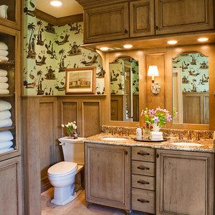 Esempio di una stanza da bagno padronale chic di medie dimensioni con ante con riquadro incassato, ante in legno scuro, vasca freestanding, doccia aperta, piastrelle beige, piastrelle in gres porcellanato, pareti multicolore, pavimento in travertino e lavabo sottopiano