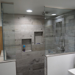 Bathroom - mid-sized transitional 3/4 gray tile and ceramic tile laminate floor and gray floor bathroom idea in Other with shaker cabinets, white cabinets, a two-piece toilet, gray walls, an undermount sink and quartz countertops