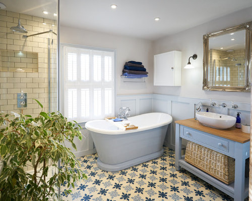 Photo Of A Large Nautical Ensuite Bathroom In Sussex With Raised Panel  Cabinets, Blue