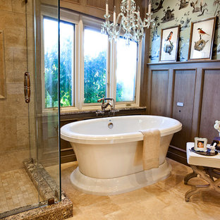 Mid-sized elegant master beige tile and porcelain tile travertine floor bathroom photo in St Louis with recessed-panel cabinets, medium tone wood cabinets, multicolored walls, an undermount sink and a hinged shower door