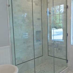 Corner shower - mid-sized craftsman master white tile and stone tile marble floor corner shower idea in Los Angeles with an undermount sink, shaker cabinets, white cabinets, marble countertops and gray walls