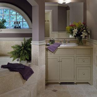 Bathroom - traditional stone tile beige floor bathroom idea in New York