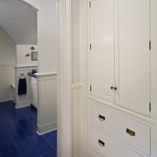 Bathroom - traditional blue floor bathroom idea in New York with white cabinets