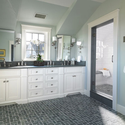 Example of a mid-sized classic master gray tile slate floor alcove shower design in Boston with recessed-panel cabinets, white cabinets, an undermount sink and granite countertops