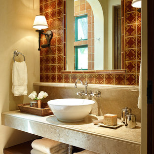 Inspiration for a mid-sized mediterranean master multicolored tile and ceramic tile terra-cotta floor bathroom remodel in San Francisco with a vessel sink, open cabinets, beige walls and solid surface countertops