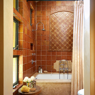 Example of a mid-sized tuscan master multicolored tile and terra-cotta tile terra-cotta floor bathroom design in San Francisco with an undermount tub, beige walls and a one-piece toilet
