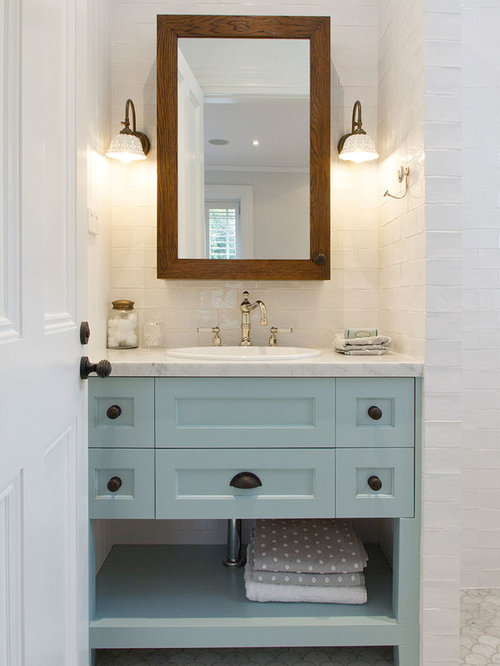 Photo Of A Medium Sized Country Family Bathroom In Sydney With Recessed Panel Cabinets