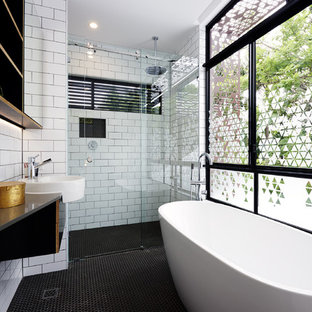 Design ideas for a contemporary master bathroom in Brisbane with a freestanding tub, a curbless shower, white tile, subway tile, white walls and an integrated sink.
