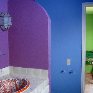 На фото: ванная комната в современном стиле с накладной раковиной, столешницей из плитки, белой плиткой, синими стенами, полом из терракотовой плитки и душевой кабиной