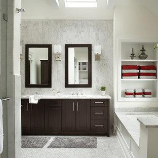 Foto di una stanza da bagno chic con ante in stile shaker, ante in legno bruno, piastrelle bianche e vasca sottopiano