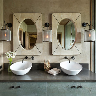 Example of a mid-sized mountain style master gray tile alcove shower design in Other with flat-panel cabinets, blue cabinets, beige walls, a vessel sink, granite countertops, a hinged shower door and gray countertops