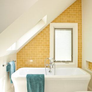 Photo of a beach style bathroom in Atlanta with a freestanding tub, subway tile, yellow tile, yellow walls, mosaic tile floors and white floor.