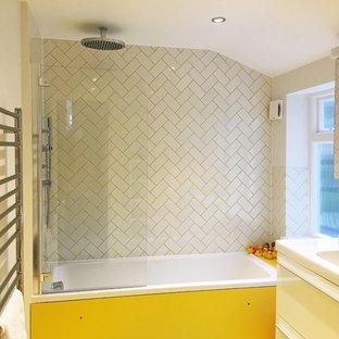 Yellow bathroom in North London renovation
