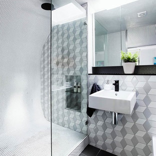Inspiration for a contemporary gray tile black floor alcove shower remodel in Los Angeles with a wall-mount sink