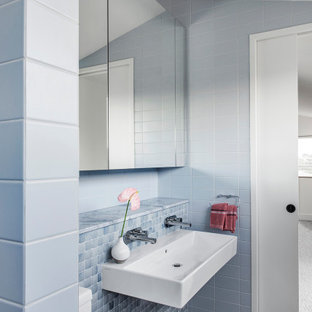 Design ideas for a large contemporary bathroom in Brisbane with white cabinets, an alcove tub, a one-piece toilet, blue tile, ceramic tile, white walls, a wall-mount sink and a hinged shower door.