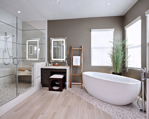 Nice Inspiration For A Contemporary Master Pebble Tile Floor And Beige Floor  Freestanding Bathtub Remodel In Orange Part 14