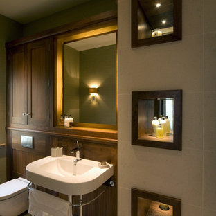 Inspiration for a transitional beige tile bathroom remodel in Other with shaker cabinets, dark wood cabinets, a wall-mount toilet and a console sink