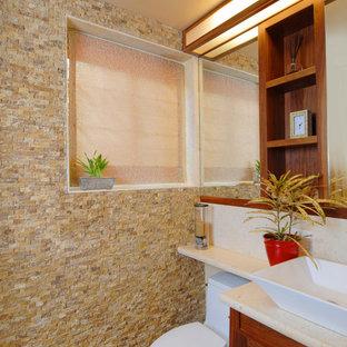 Bathroom - contemporary limestone tile bathroom idea in San Francisco with a vessel sink