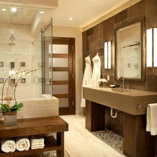 Large master brown tile and stone tile porcelain floor and beige floor wet room photo in San Francisco with beige walls, an integrated sink, engineered quartz countertops and a hinged shower door