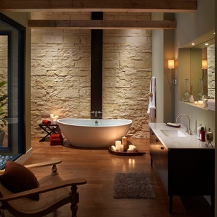 Zen Bathroom With Cut Coarse Stone Accent Wall