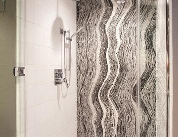Zen like shower with granite countertop