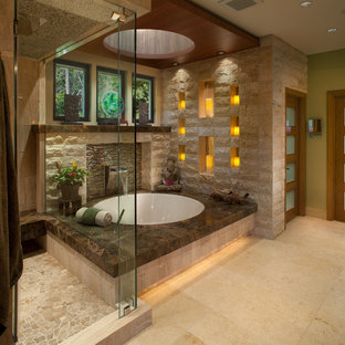 Design ideas for a large world-inspired ensuite bathroom in San Diego with green walls, a submerged bath, a corner shower, marble flooring and limestone tiles.