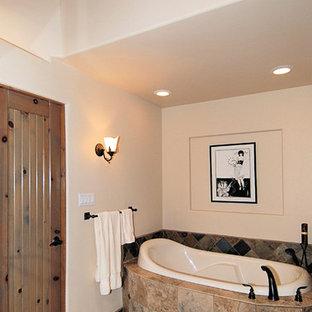 Imagen de cuarto de baño principal, rural, de tamaño medio, con bañera encastrada, sanitario de una pieza, paredes blancas, lavabo encastrado, armarios con paneles con relieve, puertas de armario de madera oscura, ducha esquinera, baldosas y/o azulejos de pizarra y ducha con puerta con bisagras
