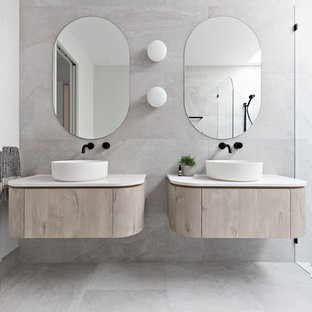 Design ideas for a modern bathroom in Central Coast with flat-panel cabinets, light wood cabinets, beige tile, white walls, a vessel sink, beige floor and white benchtops.