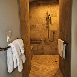 Example of a huge classic master beige tile and ceramic tile ceramic floor and beige floor bathroom design in Charlotte with an undermount tub