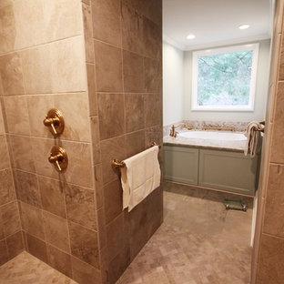 Huge elegant master beige tile and ceramic tile ceramic floor and beige floor bathroom photo in Charlotte with an undermount tub