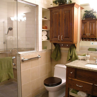 Mid-sized elegant beige tile and porcelain tile porcelain floor alcove shower photo in Calgary with an undermount sink, raised-panel cabinets, medium tone wood cabinets, engineered quartz countertops and beige walls
