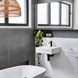 Photo of a small contemporary master bathroom in Sunshine Coast with a freestanding tub, white tile, mosaic tile, ceramic floors and grey floor.