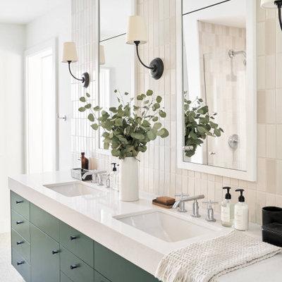 Bathroom - large mid-century modern master white tile terrazzo floor, white floor and double-sink bathroom idea in Austin with flat-panel cabinets, green cabinets, white walls, a drop-in sink, white countertops and a built-in vanity