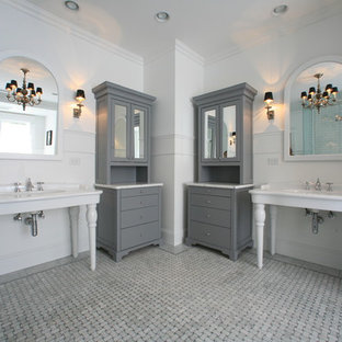 Inspiration for an eclectic bathroom remodel in Raleigh with a console sink, marble countertops and gray cabinets